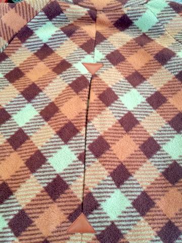 Réaliser un pli creux dans le milieu du dos du blouson